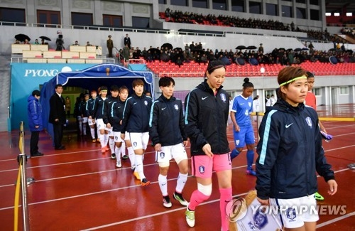 South Korean women's national football team players enter Kim Il-sung Stadium in Pyongyang on April 5, 2017 to play a 2018 AFC Women's Asian Cup qualifying match against India. (Joint Press Corps)
