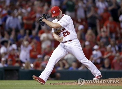 In this Associated Press photo, Oh Seung-hwan of the St. Louis Cardinals celebrates after striking out Chris Taylor of the Los Angeles Dodgers to save the Cardinals' 2-1 victory in their Major League Baseball regular season game at Busch Stadium in St. Louis on May 31, 2017. (Yonhap)