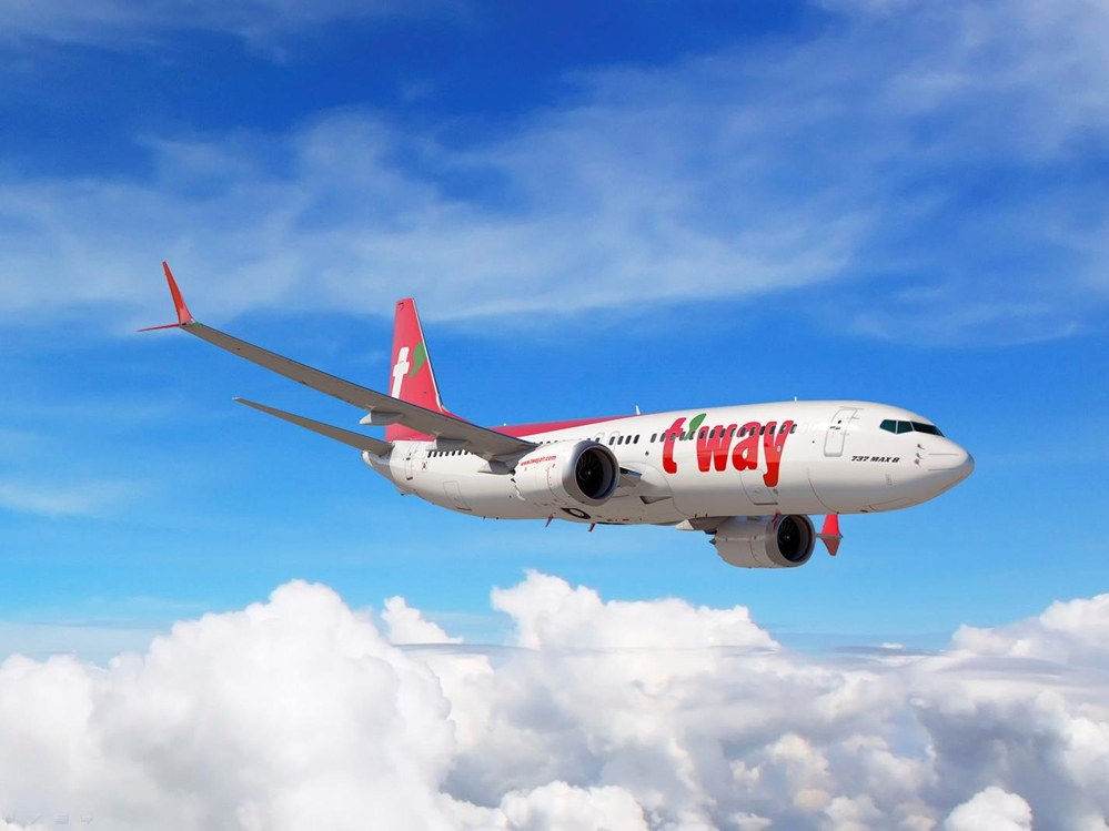 This image provided by T'way Air shows a Boeing 737 MAX 8 painted with the budget carrier's red and green livery. (Yonhap)