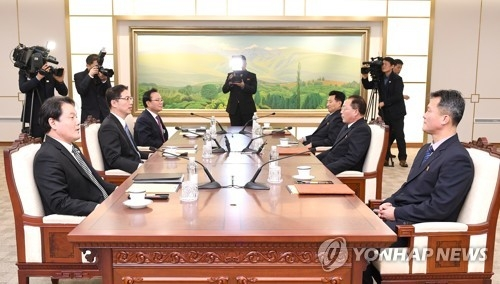 This photo, provided by Seoul's unification ministry on Jan. 17, 2018, shows working-level talks between the two Koreas on the North's participation in the PyeongChang Winter Olympics. (Yonhap)
