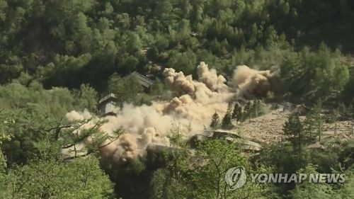 This image captured from Yonhap News TV shows the demolition of North Korea's Punggye-ri nuclear test site on May 24, 2018. (Yonhap)