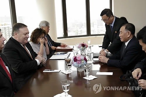 This AP photo shows U.S. Secretary of State Mike Pompeo (L) meeting with Kim Yong-chol (R), vice chairman of the central committee of North Korea's ruling Workers' Party, in New York on May 31, 2018. (Yonhap)