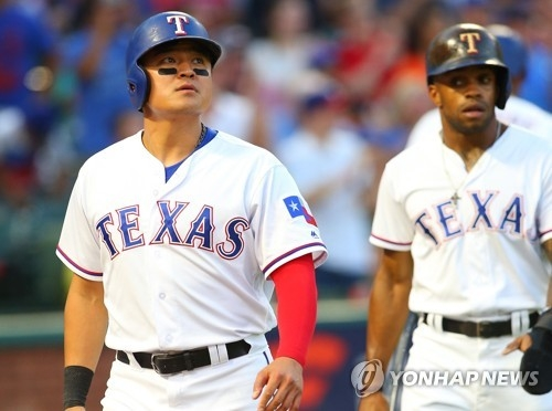In this Getty Images photo from June 8, 2018, Choo Shin-soo of the Texas Rangers (L) walks to the dugout after scoring in the bottom of the third inning of a major league regular season game against the Houston Astros at Globe Park in Arlington, Texas. (Yonhap)