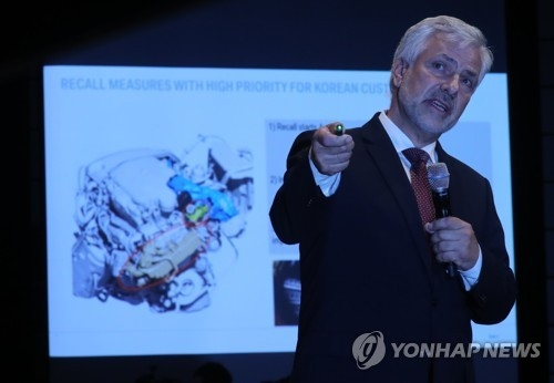 In this photo taken on Aug. 6, 2018, Vice President Johann Ebenbichler in charge of quality at BMW Group delivers a briefing on the cause of fires in its vehicles in South Korea this year. (Yonhap)