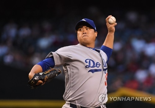 In this Getty Images file photo from May 2, 2018, Ryu Hyun-jin of the Los Angeles Dodgers throws a pitch against the Arizona Diamondbacks in the bottom of the first inning of a Major League Baseball regular season game at Chase Field in Phoenix. Ryu sustained a groin injury during that game and hasn't pitched in the majors since. (Yonhap)