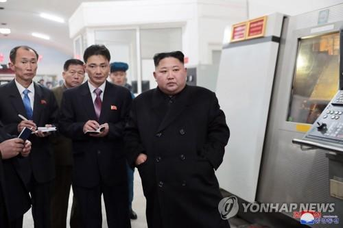 Kim Jong-un calls for modernized production in visit to glass victory