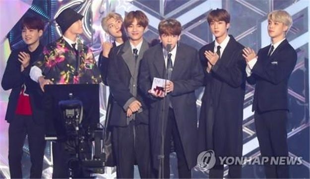 BTS addresses the spectators after winning an award at MBC Plus X Genie Music Awards on Nov. 6, 2018. (Yonhap)