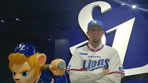 American pitcher Deck McGuire in his new Samsung Lions uniform after signing with the Korea Baseball Organization club on Nov. 29, 2018, in this photo released by the team. (Yonhap)
