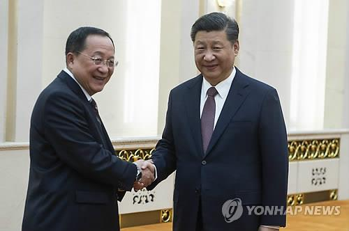 In this photo taken by the Associated Press, North Korean Foreign Minister Ri Yong-ho (L) shakes hands with Chinese President Xi Jinping at the Great Hall of the People in Beijing on Dec. 7, 2018. (Yonhap)