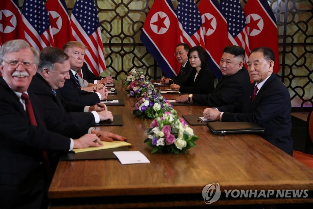 This Reuters photo shows U.S. National Security Adviser John Bolton (L) smiling during summit talks between President Donald Trump and North Korean leader Kim Jong-un in Hanoi, Vietnam, on Feb. 28, 2019. (Yonhap)