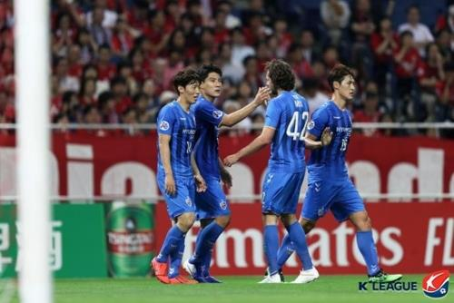 In this photo provided by the K League, Joo Min-kyu of Ulsan Hyundai FC (2nd from L) celebrates his goal against Urawa Red Diamonds in the round of 16 match at the Asian Football Confederation Champions League at Saitama Stadium 2002 in Saitama, Japan, on June 19, 2019. (PHOTO NOT FOR SALE) (Yonhap)