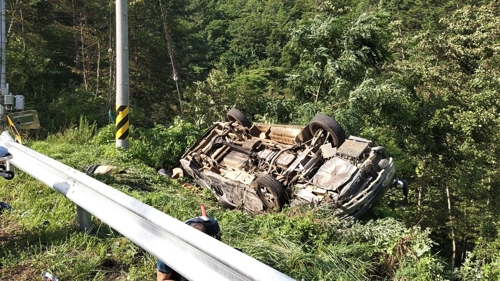 This photo, released by the Gangwon Fire Agency on July 22, 2019, shows an overturned van next to a road in the city of Samcheok, Gangwon Province, northeastern South Korea. (PHOTO NOT FOR SALE) (Yonhap)
