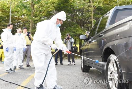 A vehicle is doused with disinfectant solution in Goyang, Gyeonggi Province, northwest of Seoul, on Sept. 27, 2019, in this photo provided by the Ministry of the Interior and Safety. (PHOTO NOT FOR SALE) (Yonhap)