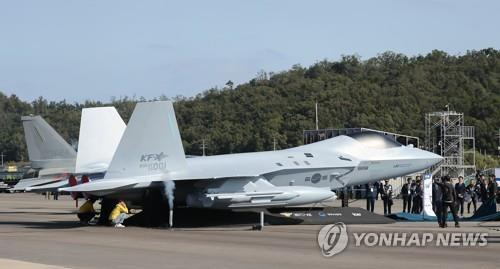 South Korea unveils a mock-up of the KF-X fighter jet, an envisioned indigenous cutting-edge fighter aircraft, during the opening ceremony of the Seoul International Aerospace & Defense Exhibition (ADEX) at Seoul Air Base in Seongnam, Gyeonggi Province, on Oct. 15, 2019. (Yonhap)