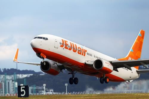 This file photo, provided by Jeju Air, shows a Jeju Air plane taking off at an airport in South Korea. (PHOTO NOT FOR SALE) (Yonhap)