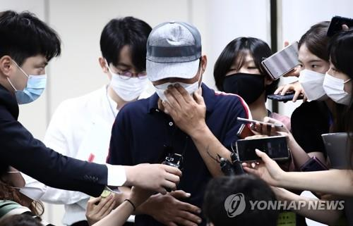 The father of the criminal Son Jung-woo, who ran one of the world's biggest child porn sites, talks to reporters after the third hearing in his son's case at the Seoul High Court in Seoul on July 6, 2020. (Yonhap)