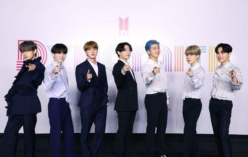 """This photo, released by Big Hit Entertainment on Aug. 21, 2020, shows K-pop band BTS attending a virtual press conference, broadcast through YouTube, to mark the release of its new song, """"Dynamite."""" (PHOTO NOT FOR SALE) (Yonhap)"""