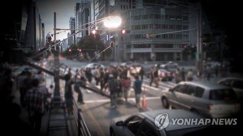 In this undated file photo provided by Yonhap News TV, a film crew shoots a film. (PHOTO NOT FOR SALE) (Yonhap)