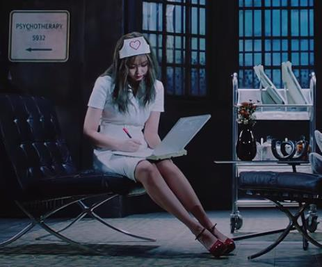 """This screenshot from K-pop group BLACKPINK's latest music video """"Lovesick Girls"""" shows member Jennie wearing a hair cap, a white dress and red high heels. (PHOTO NOT FOR SALE) (Yonhap)"""