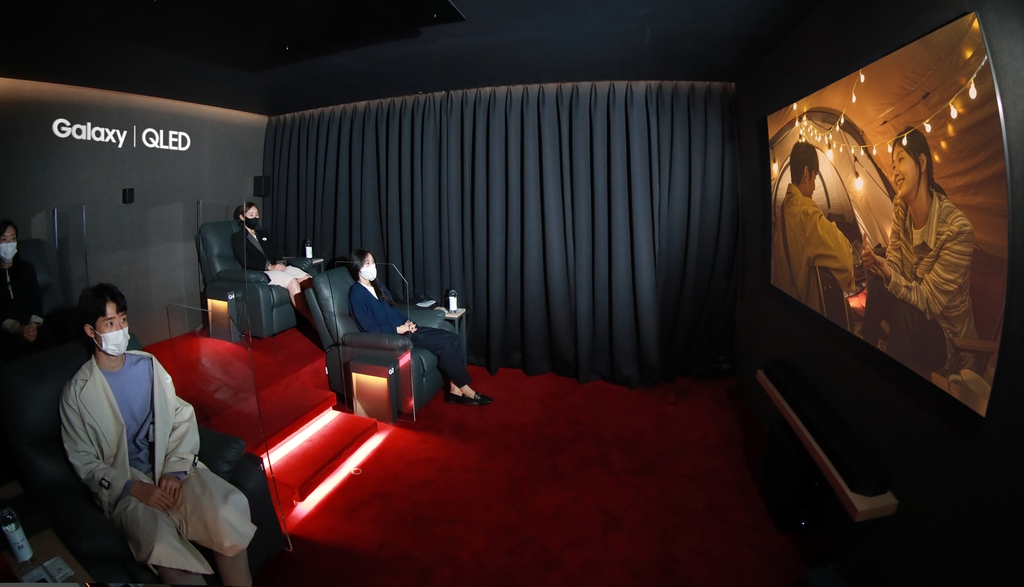 "This photo provided by Samsung Electronics Co. on Oct. 16, 2020, shows people watching the movie ""Untact,"" which was filmed on Samsung's Galaxy smartphones in 8K, at the company's special movie theater in Seoul. (PHOTO NOT FOR SALE) (Yonhap)"