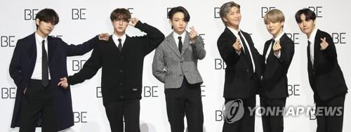 "BTS members pose for photos during a press conference on Nov. 20, 2020 held in Seoul for the group's new album ""BE."" Member Suga was absent due to a recent shoulder surgery. (Yonhap)"