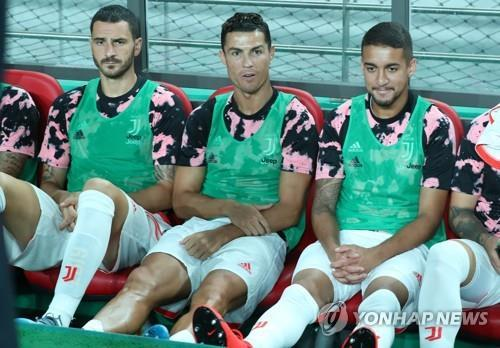 This photo from July 26, 2019, shows Cristiano Ronaldo (C) sitting on the bench during the exhibition match held between a K League All-Star team and Juventus FC at Seoul World Cup Stadium. (Yonhap)