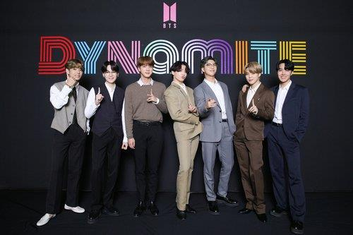 """This photo, provided by Big Hit Entertainment, shows the members of BTS posing for photos during an online media day event in Seoul on Sept. 2, 2020. The band's """"Dynamite"""" topped Billboard's main Hot 100 singles chart in the United States on Aug. 31. (PHOTO NOT FOR SALE) (Yonhap)"""
