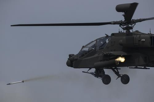 An AH-64E Apache Guardian attack helicopter of the South Korean Army fires a rocket during a joint drill with the U.S. military at a training field in Pocheon, Gyeonggi Province, on April 26, 2017. (Yonhap)