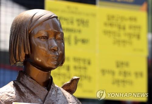 This photo, taken on April 21, 2021, shows a statue symbolizing victims of Japan's wartime sexual slavery in front of the Japanese Embassy in Seoul. (Yonhap)