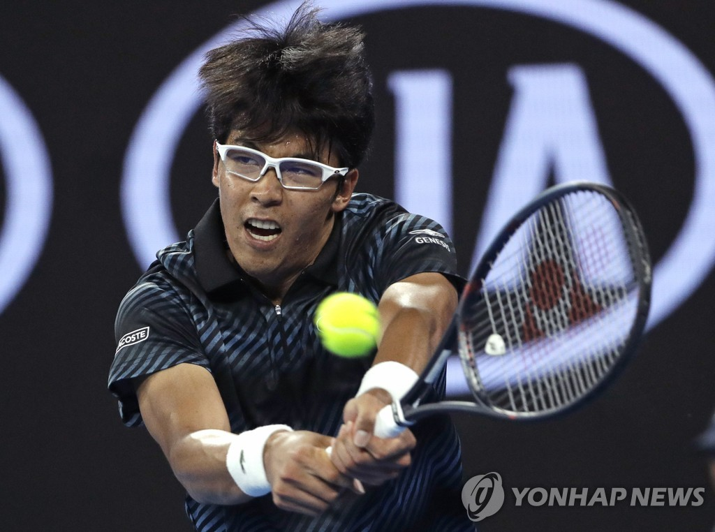 In this Associated Press photo, Chung Hyeon of South Korea hits a return against Pierre-Hugues Herbert of France during their men's singles match at the Australian Open at Melbourne Arena in Melbourne on Jan. 17, 2019. (Yonhap)