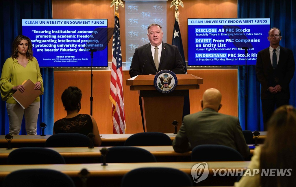In this AFP photo, taken on Sept. 2, 2020, U.S. Secretary of State Mike Pompeo (at podium) holds a press conference at the Department of State in Washington. (PHOTO NOT FOR SALE) (Yonhap)