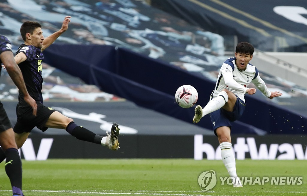 In this EPA photo, Son Heung-min of Tottenham Hotspur (R) takes a shot during a Premier League match against Newcastle United at Tottenham Hotspur Stadium in London on Sept. 27, 2020. (Yonhap)