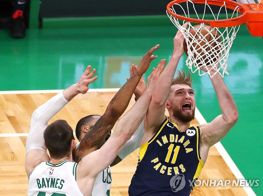 In this Getty Images file photo from April 17, 2019, Domantas Sabonis of the Indiana Pacers (R) attempts a shot against the Boston Celtics during the second quarter of Game 1 of their first round NBA playoff series at TD Garden in Boston. (Yonhap)