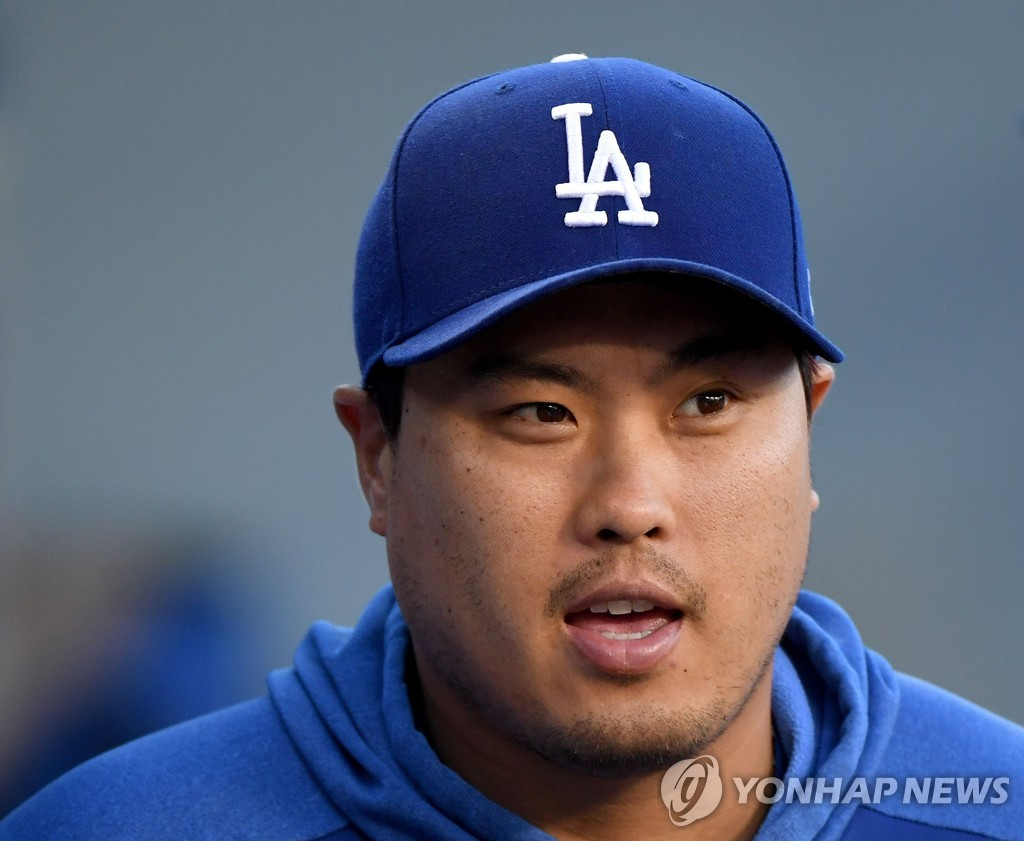 In this Getty Images file photo from Aug. 6, 2019, Ryu Hyun-jin of the Los Angeles Dodgers smiles in the dugout before a Major League Baseball regular season game against the St. Louis Cardinals at Dodger Stadium in Los Angeles. (Yonhap)