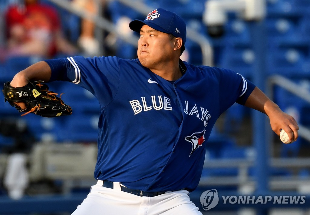 In this USA Today Sports photo via Reuters, Ryu Hyun-jin of the Toronto Blue Jays pitches against the Philadelphia Phillies in the top of the first inning of a major league spring training game at TD Ballpark in Dunedin, Florida, on March 26, 2021. (Yonhap)