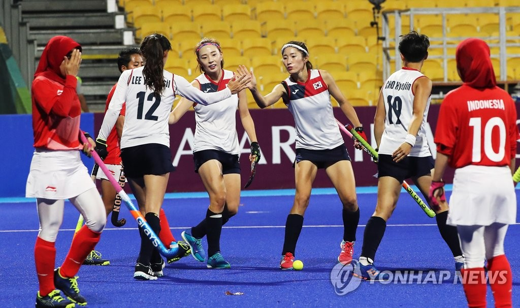 In this file photo from Aug. 21, 2018, South Korean players (in white) celebrate a goal against Indonesia during a women's field hockey preliminary game at the 18th Asian Games at GBK Hockey Field in Jakarta. (Yonhap)