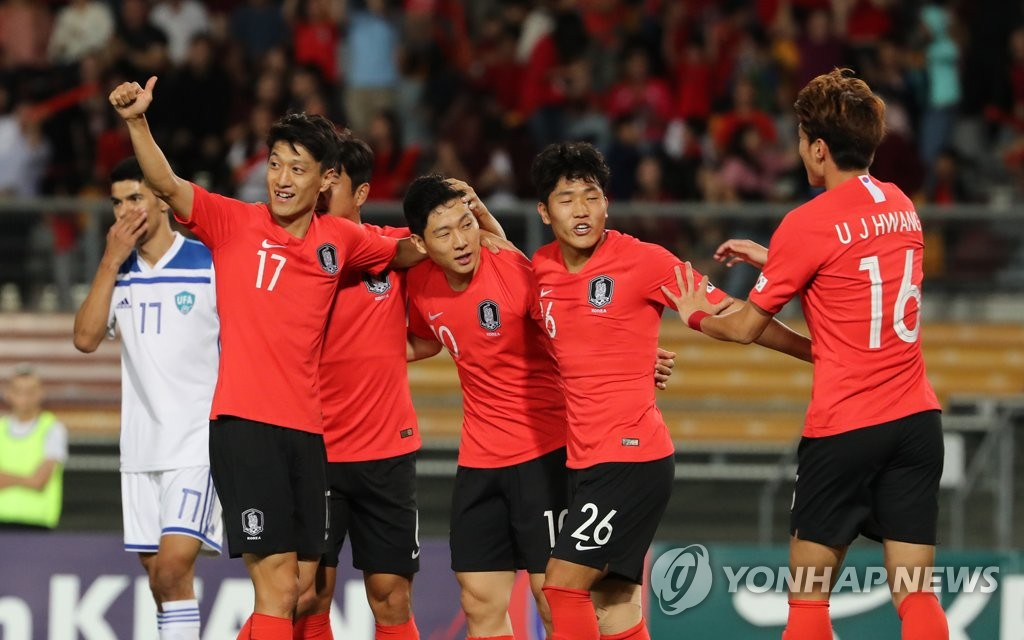 South Korea national football team players celebrate after scoring a goal against Uzbekistan in a friendly football match at the Queensland Sport and Athletics Centre (QSAC) in Nathan, a suburb of Brisbane, Australia, on Nov. 20, 2018. (Yonhap)