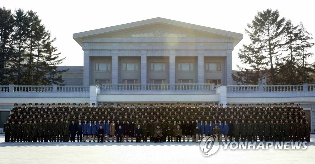 NK leader with art troupe