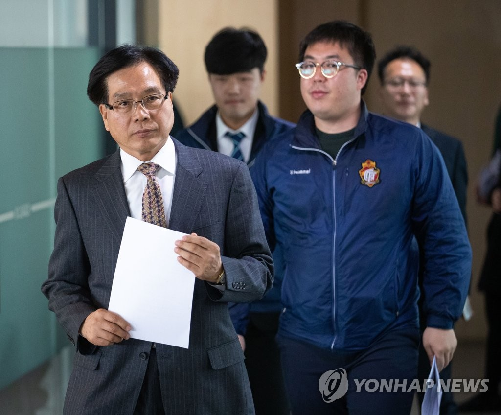 In this file photo, taken on April 2, 2019, Gyeongnam FC officials, including CEO Cho Ki-ho (L), arrive at the KFA House in Seoul to attend a K League disciplinary committee meeting. (Yonhap)