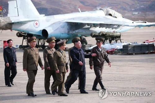 NK leader guides flight drill