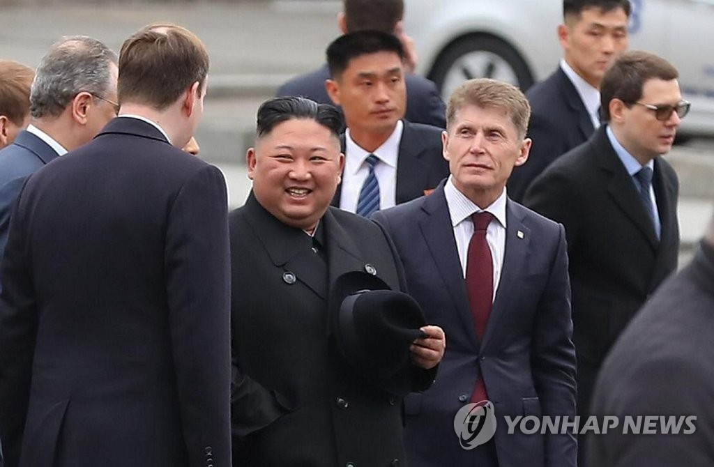 North Korean leader Kim Jong-un (C) talks with Russia officials upon arriving in Russia's Far East city of Vladivostok on April 24, 2019, in this photo provided by the Primorsky Krai government. (Yonhap)