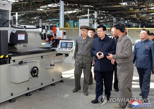 NK's new premier inspects factory
