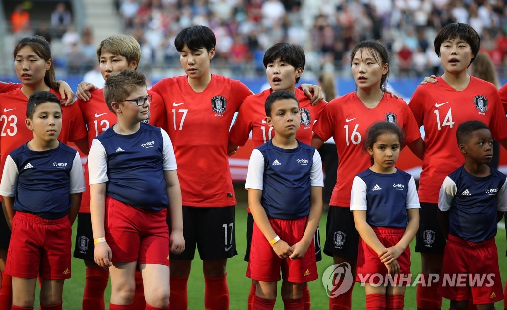 In this file photo from June 17, 2019, South Korean players stand for the national anthem before their Group A match against Norway at the FIFA Women's World Cup at Stade Auguste-Delaune in Reims, France. (Yonhap)