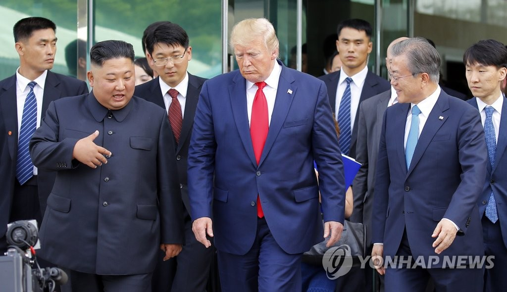 From left: North Korean leader Kim Jong-un, U.S. President Donald Trump and South Korean President Moon Jae-in talk as they leave the Freedom House in the border village of Panmunjom on June 30, 2019. (Yonhap)