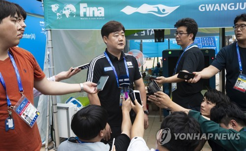 Kim In-kyun, head coach of the swimming club at North Gyeongsang Provincial Government, speaks to reporters at the athletes' village for the FINA World Championships in Gwangju, 330 kilometers south of Seoul, on July 17, 2019. (Yonhap)
