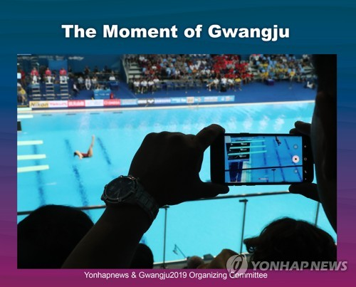 Spectator photographs diver in Gwangju