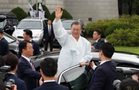 Moon presents 'unshakable nation' vision, extends olive branch to Japan