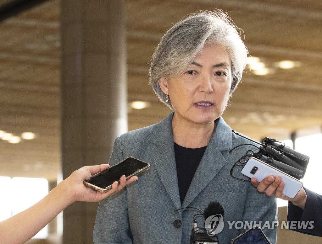 Foreign Minister Kang Kyung-wha speaks to the press before departing for China at Gimpo International Airport in western Seoul on Aug. 20, 2019. (Yonhap)
