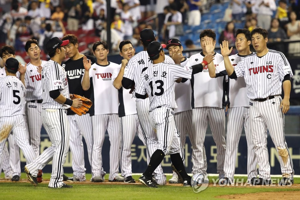 In this file photo from Aug. 20, 2019, members of the LG Twins celebrate their 15-3 victory over the Kia Tigers in their Korea Baseball Organization regular season game at Jamsil Stadium in Seoul. (Yonhap)