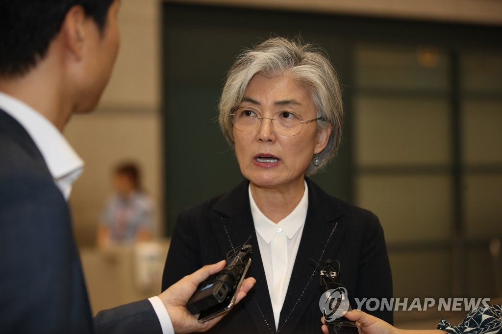 Foreign Minister Kang Kyung-wha speaks to the press upon arriving at Incheon International Airport, west of Seoul, on Aug. 22, 2019. (Yonhap)